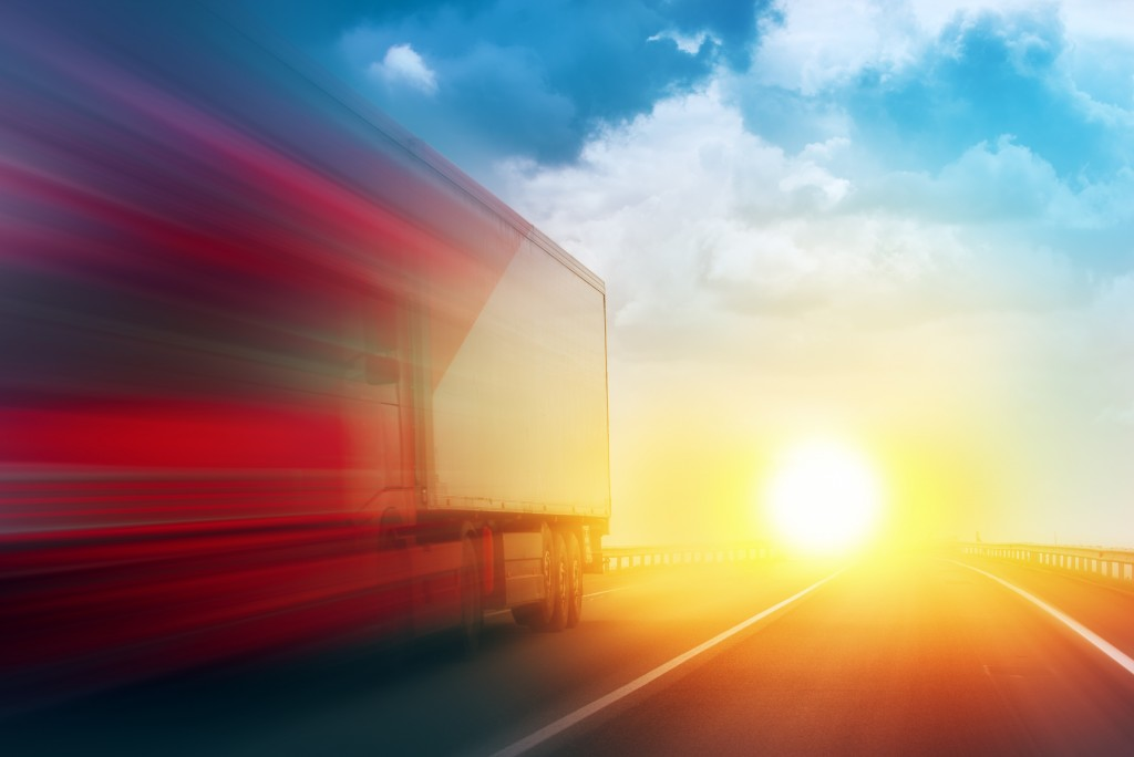 Speeding Transportation Delivery Truck on Open Highway